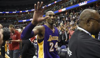 Los Angeles Lakers forward Kobe Bryant (24) waves as he leaves the court after an NBA basketball game against the Washington Wizards, Wednesday, Dec. 2, 2015, in Washington. The Lakers won 108-104. (AP Photo/Nick Wass)