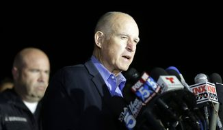 California Gov. Jerry Brown reacts as he speaks during a press conference near the site of yesterday's mass shooting on Thursday, Dec. 3, 2015 in San Bernardino, Calif. A husband and wife on Wednesday, dressed for battle and carrying assault rifles and handguns, opened fire on a holiday banquet for his co-workers, killing at least 14 people and seriously wounding more than a dozen others in a precision assault, authorities said. Hours later, the couple died in a shootout with police. (AP Photo/Chris Carlson)