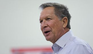 Republican presidential candidate, Ohio Gov. John Kasich answers an audience question during a town hall style meeting at the Fisk Middle School in Salem, N.H., Thursday, Dec. 3, 2015. (AP Photo/Charles Krupa)