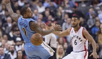 Denver Nuggets guard Jameer Nelson (1) loses control of the ball as Toronto Raptors guard Cory Joseph (6) defends during the first half of an NBA basketball game in Toronto, Thursday, Dec. 3, 2015 (Nathan Denette/The Canadian Press via AP) MANDATORY CREDIT