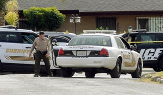 FBI, San Bernardino City and San Bernardino County Sheriff's officials continue documenting and investigating on Thursday, Dec. 3, 2015 the scene of the shootout between law enforcement officials and the mass shooting suspects which occurred on Wednesday. (James Quigg/The Victor Valley Daily Press via AP) MANDATORY CREDIT