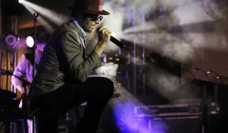 "In this Nov. 24, 2008, file photo, singer Scott Weiland performs at the Hollywood & Highland complex in Los Angeles to promote his new album, ""Happy in Galoshes."" Weiland, the former frontman for the Stone Temple Pilots and Velvet Revolver, has died. He was 48. The singer's manager, Tom Vitorino, confirmed the death to The Associated Press early Friday, Dec. 4, 2015. (AP Photo/Chris Pizzello, File)"