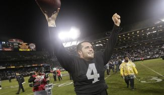 FILE  - In this Nov. 20, 2014, file photo, Oakland Raiders quarterback Derek Carr (4) celebrates after the Raiders defeated the Kansas City Chiefs 24-20 in an NFL football game in Oakland, Calif. That was a sign of things to come for Carr, whose dramatic improvement in year two is the biggest reason why the Raiders (5-6) are still in the playoff hunt in December heading into Sunday's home game against the streaking Chiefs (6-5). (AP Photo/Marcio Jose Sanchez, File)