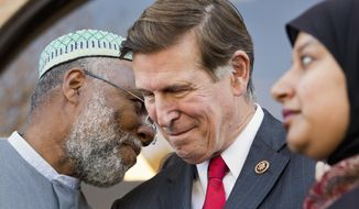 Imam Johari Abdul-Malik, left, speaks to Rep. Don Beyer, D-Va., as he and other local elected officials speak to the media after attending Friday prayers at Dar al-Hijrah Mosque in Falls Church, Va., Friday, Dec. 4, 2015. Beyer and other elected officials attended prayer services at the northern Virginia mosque as a show of solidarity with the region's Muslim population. (AP Photo/Jacquelyn Martin)