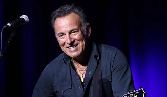 In this Nov. 10, 2015, file photo, Bruce Springsteen performs at the 9th Annual Stand Up For Heroes event in New York. (Photo by Greg Allen/Invision/AP)