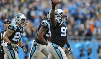 FILE- In this Nov. 8, 2015, file photo, Carolina Panthers' Kyle Love (93) celebrates after recovering a fumble against the Green Bay Packers in the first half of an NFL football game in Charlotte, N.C. As the lone remaining unbeaten team, the Panthers have made believers across the NFL. One major reason for their success as they head to New Orleans is their skill at protecting and taking away the football. (AP Photo/Mike McCarn, File)