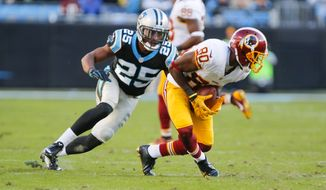 Carolina Panthers cornerback Bene' Benwikere (25) pursues Washington Redskins defensive end Stephen Paea (90) during an NFL game at Bank of America Stadium in Charlotte, N.C. on Sunday, Nov. 22, 2015. (Chris Keane/AP Images for Panini)