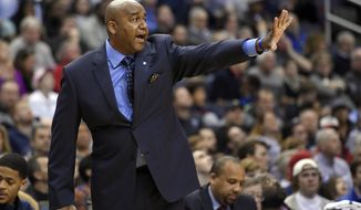 Georgetown head coach John Thompson III gestures during the first half of an NCAA college basketball game against Syracuse, Saturday, Dec. 5, 2015, in Washington. Georgetown won 79-72. (AP Photo/Nick Wass) **FILE**