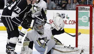 Pittsburgh Penguins goalie Marc-Andre Fleury (29) stop a shot by Los Angeles Kings center Tyler Toffoli (73) during the second period of an NHL hockey game in Los Angeles, Saturday, Dec. 5, 2015. (AP Photo/Alex Gallardo)