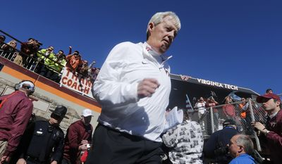 Virginia Tech head coach Frank Beamer runs out to the field prior to the start of an NCAA college football game in Blacksburg, Va., Saturday, Nov. 21, 2015. It is the last home game for Tech coach Frank Beamer who has announced his retirement. (AP Photo/Steve Helber)