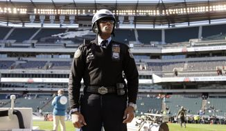 A Philadelphia police officer stands posted inside Lincoln Financial Field during warm-ups before an NFL football game between the Philadelphia Eagles and the Miami Dolphins, Sunday, Nov. 15, 2015, in Philadelphia. The NFL said it had been in contact with the Department of Homeland Security and the FBI and planned increased security inside and outside stadiums on Sunday. League officials discouraged fans from bringing bags.(AP Photo/Matt Rourke)