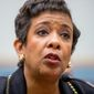 """""""When you see that person slipping off the grid, changing into someone that you no longer know, and gives you concern for that, we are no longer in a time where that kind of thing can be left aside,"""" said Attorney General Loretta Lynch. (Associated Press)"""