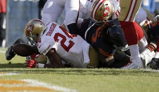 San Francisco 49ers running back Shaun Draughn (24) dives to the end zone for a touchdown against the Chicago Bears during the first half of an NFL football game, Sunday, Dec. 6, 2015, in Chicago. (AP Photo/Nam Y. Huh)