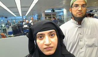 This July 27, 2014, photo provided by U.S. Customs and Border Protection shows Tashfeen Malik, left, and Syed Farook, as they passed through O'Hare International Airport in Chicago. The husband and wife died on Dec. 2, 2015, in a gun battle with authorities several hours after their assault on a gathering of Farook's colleagues in San Bernardino, Calif. (U.S. Customs and Border Protection via AP)