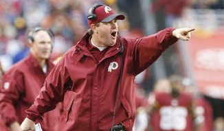 FILE - In this Nov. 29,2015 file photo, Washington Redskins head coach Jay Gruden points toward the field as he protests a call during the second half of an NFL football game against the New York Giants in Landover, Md. With six last-place finishes in the past seven years, the Washington Redskins have not mattered all that much in the latter stages of recent seasons. Just look at them now. They're actually relevant. Yes, despite all of their flaws, and despite their sub-.500 record, the Redskins stand atop the NFC East with five games to go, even with the New York Giants at 5-6. (AP Photo/Patrick Semansky, File)