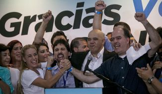 Venezuelan opposition leaders celebrated in Caracas early Monday after winning control of the National Assembly by a landslide, delivering a major setback to the ruling party and altering the balance of power after 17 years of socialist rule. (Associated Press)
