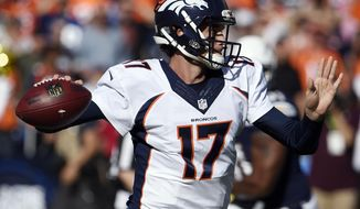 Denver Broncos quarterback Brock Osweiler passes against the San Diego Chargers during the first half in an NFL football game Sunday, Dec. 6, 2015, in San Diego. (AP Photo/Denis Poroy)