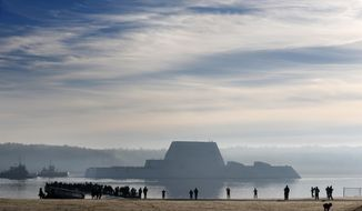 The first Zumwalt-class destroyer, the largest ever built for the U.S. Navy, heads down the Kennebec River after leaving Bath Iron Works, Monday, Dec. 7, 2015, in Bath, Maine. The ship is headed out to sea for the first time to undergo sea trials.(AP Photo/Robert F. Bukaty)