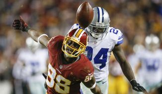 Washington Redskins wide receiver Pierre Garcon (88) looks as a pass gets away form him under pressure from Dallas Cowboys cornerback Morris Claiborne (24) during the second half of an NFL football game in Landover, Md., Monday, Dec. 7, 2015. (AP Photo/Patrick Semansky)