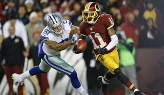 Washington Redskins wide receiver DeSean Jackson (11) carries the ball on a kickoff return under pressure from Dallas Cowboys outside linebacker Kyle Wilber (51) during the second half of an NFL football game in Landover, Md., Monday, Dec. 7, 2015. Jackson later fumbled the play on the play. The Cowboys defeated the Redskins 19-16. (AP Photo/Patrick Semansky)