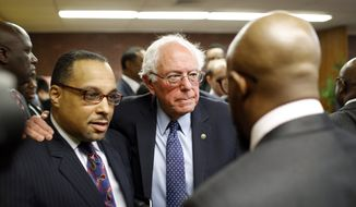 Democratic presidential candidate, Sen. Bernie Sanders, I-Vt., center, puts his arm around Rev. Todd Yeary of Baltimore, as he speaks with African-American civic and religious leaders at the Freddie Gray Empowerment Center in Baltimore, Tuesday, Dec. 8, 2015, after taking a walking tour of Gray's neighborhood and participating in a roundtable discussion on issues affecting the African-American community. (AP Photo/Patrick Semansky) ** FILE **