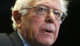 Democratic presidential candidate, Sen. Bernie Sanders, I-Vt., speaks at a news conference after taking a walking tour of Freddie Gray's neighborhood and meeting with African-American civic and religious leaders in Baltimore, Tuesday, Dec. 8, 2015. (AP Photo/Patrick Semansky)