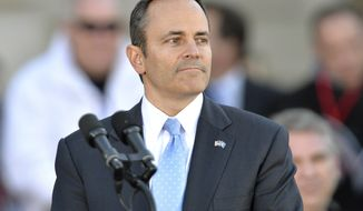 Kentucky Governor Matt Bevin looks out over the audience before giving his speech after taking the oath of office to become the 62nd Governor of the Commonwealth of Kentucky during a public ceremony, Tuesday, Dec. 8, 2015, in Frankfort, Ky. (AP Photo/Timothy D. Easley)