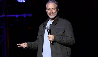 "FILE - In this Tuesday, Nov. 10, 2015, file photo, comedian Jon Stewart performs at the 9th Annual Stand Up For Heroes event, presented by the New York Comedy Festival and The Bob Woodruff Foundation, at the Theater at Madison Square Garden in New York. Stewart has returned to ""The Daily Show"" where he made a push to renew a law that provides health benefits for first responders who became ill after the Sept. 11 terror attacks. Stewart was a guest on the ""Daily Show with Trevor Noah"" on Monday, Dec. 8, 2015. (Photo by Greg Allen/Invision/AP, File)"