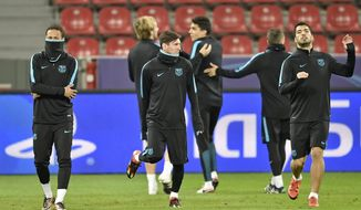 Barcelona's forwards Neymar, Lionel Messi and Luis Suarez, from left, exercise during the final training session at the BayArena prior the Champions League group E soccer match between Bayer Leverkusen and FC Barcelona in Leverkusen, Germany, Tuesday, Dec. 8, 2015. (AP Photo/Martin Meissner)