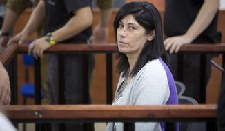 File - This Thursday, May 21, 2015 role photo shows Palestinian Parliament member  Khalida Jarrar of the Popular Front for the Liberation of Palestine (PFLP) attending a court session at the Israeli Ofer military base near the West Bank city of Ramallah.  Israeli military said  it has sentenced Jarrear to 15 months in prison after convicting her of belonging to an illegal organization and incitement.  (AP Photo/Majdi Mohammed, File)