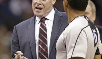 Charlotte Hornets head coach Steve Clifford, left, argues a call with an official in the first half of an NBA basketball game against the Detroit Pistons in Charlotte, N.C., Monday, Dec. 7, 2015. (AP Photo/Chuck Burton)