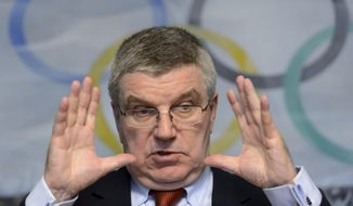 International Olympic Committee (IOC) president German Thomas Bach speaks during a media round table on the eve of an executive board meeting at the IOC headquarters, in Lausanne, Switzerland, Monday, Dec. 7, 2015. (Laurent Gillieron/Keystone via AP)