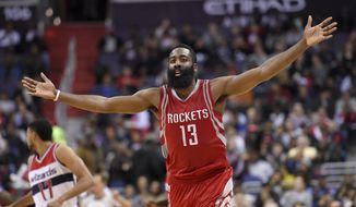 Houston Rockets guard James Harden (13) reacts during the second half of an NBA basketball game against the Washington Wizards, Wednesday, Dec. 9, 2015, in Washington. The Rockets won 109-103. (AP Photo/Nick Wass)