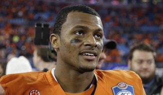 Clemson quarterback Deshaun Watson (4) is seen following Clemson's 45-37 win over North Carolina at the Atlantic Coast Conference championship NCAA college football game in Charlotte, N.C., Saturday, Dec. 5, 2015. (AP Photo/Bob Leverone)