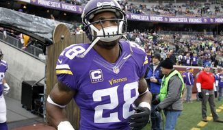Minnesota Vikings running back Adrian Peterson (28) takes the field for warmups before an NFL football game against the Seattle Seahawks, Sunday, Dec. 6, 2015 in Minneapolis. (AP Photo/Ann Heisenfelt)