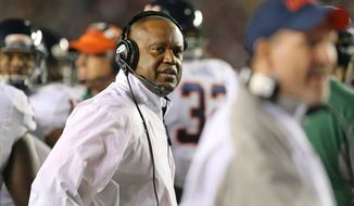FILE - In this Nov. 8, 2014, file photo, Virginia's head coach Mike London checks the action on the field during an NCAA college football game against Florida State in Tallahassee, Fla. London and offensive coordinator Steve Fairchild have reviewed every play from spring practice. (AP Photo/Steve Cannon, File)