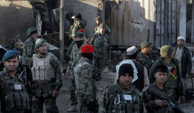 Afghan security forces inspect damages after clashes between Taliban fighters and Afghan forces in Kandahar Airfield, Afghanistan, Wednesday, Dec. 9, 2015. A Taliban assault on an airport in the southern Afghan city of Kandahar that has been underway for nearly 24 hours has killed dozens of people, the Defense Ministry said Wednesday. (AP Photos/Allauddin Khan)