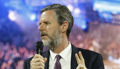 This Wednesday Nov. 11, 2015, file photo, shows Liberty University President Jerry Falwell Jr., as he introduces Republican presidential candidate Dr. Ben Carson at Liberty University, in Lynchburg, Va. (AP Photo/Steve Helber)