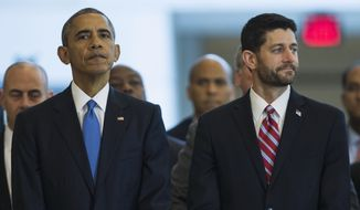President Obama stands with House Speaker Paul Ryan, Wisconsin Republican, in Emancipation Hall on Capitol Hill in Washington on Dec. 9, 2015, during an event to celebrate the 150th anniversary of the 13th amendment that abolished slavery. (Associated Press) **FILE**