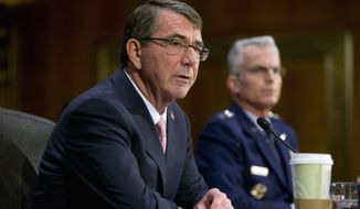 Defense Secretary Asht Carter, left, and Joints Chiefs Vice Chairman Gen. Paul Selva, testify on Capitol Hill in Washington, Wednesday, Dec. 9, 2015, before the Senate Armed Service Committee hearing on the Islamic State. Carter said the U.S. is prepared to assist the Iraqi army with more personnel and equipment to help them fight Islamic State militants. (AP Photo/Pablo Martinez Monsivais)