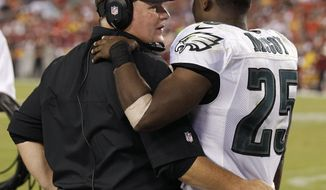 FILE - In this Sept. 9, 2013, file photo, Philadelphia Eagles head coach Chip Kelly talks with then-Eagles running back LeSean McCoy (25) along the sidelines during the second half of an NFL football game against the Washington Redskins in Landover, Md. Don't expect McCoy to be shaking Eagles' coach Kelly's hand when the Buffalo Bills running back travels to Philadelphia to face his former team for the first time on Sunday. (AP Photo/Alex Brandon, File)