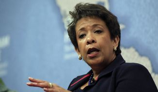 U.S. Attorney General Loretta Lynch gestures as she answers a question from the audience after speaking at Chatham House, The Royal Institute for International Affairs, in London, Wednesday, Dec. 9, 2015. (AP Photo/Alastair Grant) ** FILE **