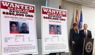 With wanted posters off to the side, Laura E. Duffy, United States Attorney Southern District of California, and FBI Special Agent in Charge James L. Turgal Jr. announce July 9, 2012, the indictments on five suspects involved in the death of U.S. Border Patrol agent Brian Terry in Tucson, Ariz. Terry's death brought to light a bungled federal gun-tracking operation known as Fast and Furious. (Associated Press) **FILE**