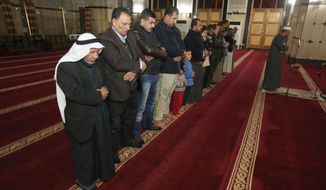 Iraqi Muslims pray at a mosque in Baghdad, Iraq, Tuesday, Dec. 8, 2015. (AP Photo/Karim Kadim)