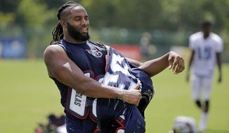 FILE - In this Aug. 11, 2015, file photo, Tennessee Titans safety Michael Griffin takes off his pads after a practice during NFL football training camp, in Nashville, Tenn. Before 2011, NFL coaches could put players in pads for practice as much as they wanted. Linebacker Wesley Woodyard and his Titans teammates have been counting down to their final padded practice Wednesday, Dec. 9, 2015, under the current labor deal that limits the pads to just three practices over the final six weeks each season. (AP Photo/Mark Humphrey, File)