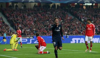 Atletico's Luciano Vietto celebrates after scoring the second goal of his team during the Champions League group C soccer match between Benfica and Atletico Madrid at the Luz stadium in Lisbon, Tuesday, Dec. 8, 2015. (AP Photo/Armando Franca)