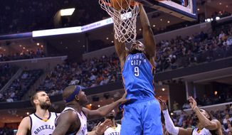 Oklahoma City Thunder forward Serge Ibaka (9) dunks the ball against Memphis Grizzlies players, from left, center Marc Gasol, forward Zach Randolph, forward Jeff Green, and guard Mike Conley in the first half of an NBA basketball game, Tuesday, Dec. 8, 2015, in Memphis, Tenn. (AP Photo/Brandon Dill)