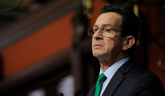 Connecticut Gov. Dannel P. Malloy, a Democrat, said Thursday that he intends to ban gun sales to people on terror watch lists. (Associated Press)