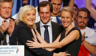 Marine Le Pen, leader of France's National Front Party, celebrates with a breakout star: her 26-year-old niece, Marion Marechal-Le Pen, who was one of the big vote-getters Sunday in the southern region of Provence-Alpes-Cote d'Azur. (Associated Press)