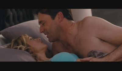 "Kristen Wiig and Jon Hamm in the 2011 romantic comedy film ""Bridesmaids."""